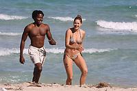 MIAMI BEACH, FL - MARCH 09: Victoria Secret Model Doutzen Kroes  kisses boyfriend DJ Rukus, on March 9, 2009 in Miami Beach, Florida.<br /> <br /> <br /> People:  Doutzen Kroes, DJ Rukus