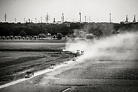 "Dust clouds from the convoy driving over the gravel sections <br /> <br /> Antwerp Port Epic 2018 (formerly ""Schaal Sels"")<br /> One Day Race: Antwerp > Antwerp (207km of which 32km are cobbles & 30km is gravel/off-road!)"