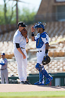 Glendale Desert Dogs relief pitcher Kyle Zurak (70), of the New York Yankees organization, is visited by Keibert Ruiz (17), of the Los Angeles Dodgers organization, during an Arizona Fall League game against the Mesa Solar Sox at Camelback Ranch on October 15, 2018 in Glendale, Arizona. Mesa defeated Glendale 8-0. (Zachary Lucy/Four Seam Images)