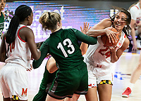 COLLEGE PARK, MD - DECEMBER 8: Stephanie Jones #24 of Maryland holds the ball away from Isabella Therien #13 of Loyola during a game between Loyola University and University of Maryland at Xfinity Center on December 8, 2019 in College Park, Maryland.