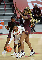 Arkansas forward Taylah Thomas (24) makes a move Thursday, Feb. 11, 2021, around Mississippi State center Jessika Carter (right) during the first half of play in Bud Walton Arena. Visit nwaonline.com/210212Daily/ for today's photo gallery. <br /> (NWA Democrat-Gazette/Andy Shupe)