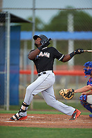 GCL Marlins outfielder Yuniel Ramirez (31) at bat during the second game of a doubleheader against the GCL Mets on July 24, 2015 at the St. Lucie Sports Complex in St. Lucie, Florida.  The game was suspended in the first inning due to rain.  (Mike Janes/Four Seam Images)