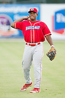 William Carmona (23) of the Lakewood BlueClaws warms up in the outfield prior to the game against the Kannapolis Intimidators at CMC-Northeast Stadium on August 13, 2013 in Kannapolis, North Carolina.  The Intimidators defeated the BlueClaws 12-8.  (Brian Westerholt/Four Seam Images)