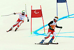 15/03/2014. Canadian skier Chris Williamson and guide Nick Brush compete in the mens's giant slalom visually impared at the Sochi 2014 Paralympic Winter Games in Sochi Russia. Photo(Scott Grant/Canadian Paralympic Committee)