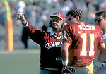Bobby Bowden talks to quarterback Casey Weldon during the 1991 FSU-Miami game in Tallahassee, Florida.  Miami defeated Florida State 17-16.  The game was lost on a kick and became knows as the Wide Right game. (Mark Wallheiser/TallahasseeStock.com)