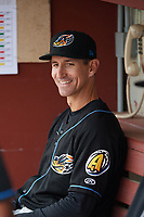 Akron RubberDucks manager Mark Budzinski (7) in the dugout before a game against the Binghamton Rumble Ponies on May 12, 2017 at NYSEG Stadium in Binghamton, New York.  Akron defeated Binghamton 5-1.  (Mike Janes/Four Seam Images)