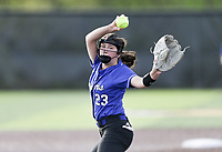 Bentonville left fielder Riley Hayes (23) throws a pitch, Thursday, April 29, 2021 during a softball game at Bentonville High School in Bentonville. Check out nwaonline.com/210430Daily/ for today's photo gallery. <br /> (NWA Democrat-Gazette/Charlie Kaijo)