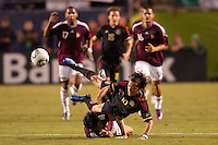 Mexican forward Giovani Dos Santos (10) is taken down. The national teams of Mexico and Venezuela played to a 1-1 draw in an International friendly match at  Qualcomm stadium in San Diego, California on  March 29, 2011...