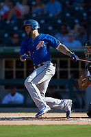 Brandon Snyder (7) of the Durham Bulls follows through on his swing against the Charlotte Knights at BB&T BallPark on July 4, 2018 in Charlotte, North Carolina. The Knights defeated the Bulls 4-2.  (Brian Westerholt/Four Seam Images)