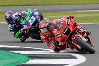 28th August 2021; Silverstone Circuit, Silverstone, Northamptonshire, England; MotoGP British Grand Prix, Qualifying Day; Ducati Lenovo Team rider Francesco Bagnaia on his Ducati Desmosedici GP21 and Sky VR46 Esponsorama Rider Enea Bastianini on his Ducati Desmosedici GP19