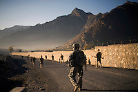Soldiers from Charlie Company, 3rd Platoon patrol in Nanglam village in the Pesh Valley. The unit was providing security for a local English school graduation ceremony in an effort to maintain support from the local community and stabilise the security in this pro-Taliban region, which sees some of the heaviest fighting in Afghanistan.