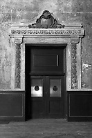Ornate doorway in the abandoned railway station on 16th St. in Oakland, California that was built built in 1912 for the Southern Pacific Railroad and later used by Amtrak.
