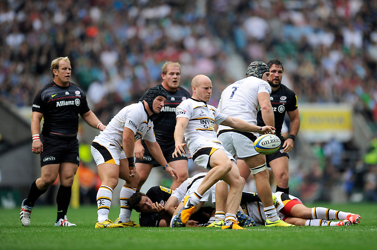 Joe Simpson of Wasps sends up a box kick during the Premiership Rugby Round 1 match between Saracens and Wasps at Twickenham Stadium on Saturday 6th September 2014 (Photo by Rob Munro)