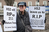 Local residents protest at loss of over 200 mature trees, a burial ground and park around Euston station to make way for HS2 construction work, London.