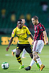 AC Milan Midfielder Jose Mauri (R) fights for the ball with Borussia Dortmund Midfielder Ousmane Dembele (L) during the International Champions Cup 2017 match between AC Milan vs Borussia Dortmund at University Town Sports Centre Stadium on July 18, 2017 in Guangzhou, China. Photo by Marcio Rodrigo Machado / Power Sport Images