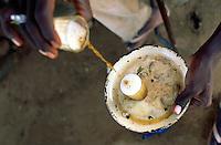 Mali. Province of Segou. Cinzana. A man prepares tea in the old malian traditionnal way. © 2003 Didier Ruef