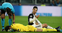 Football Soccer: UEFA Champions League -Group Stage-  Group D - Juventus vs Lokomotiv Moskva, Allianz Stadium. Turin, Italy, October 22, 2019.<br /> Juventus' Cristiano Ronaldo (r) reacts after he collided with Lokomotiv Moskva's goalkeeper Guilherme (bottom) as referee Tasos Sidiropoulos (l) checks his condition during the Uefa Champions League football soccer match between Juventus and Lokomotiv Moskva at Allianz Stadium in Turin, on October 22, 2019.<br /> UPDATE IMAGES PRESS