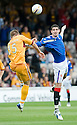 RANGERS' KYLE LAFFERTY IS PULLED BY MOTHERWELL'S SHAUN HUTCHINSON AS THEY JUMP FOR THE BALL