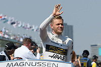 March 17, 2019: Kevin Magnussen (DEN) #20 from the Rich Energy Haas F1 Team waves to the crowd during the drivers parade prior to the start of the 2019 Australian Formula One Grand Prix at Albert Park, Melbourne, Australia. Photo Sydney Low