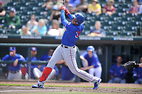 Round Rock Express first baseman Ronald Guzman (31) swings during a game against the Iowa Cubs at Principal Park on April 16, 2017 in Des  Moines, Iowa.  The Cubs won 6-3.  (Dennis Hubbard/Four Seam Images)
