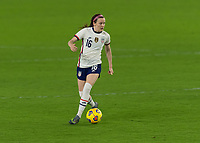 ORLANDO CITY, FL - FEBRUARY 18: Rose Lavelle #16 looks for options with the ball during a game between Canada and USWNT at Exploria stadium on February 18, 2021 in Orlando City, Florida.