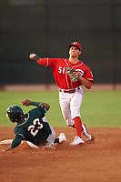 AZL Reds shortstop Yan Contreras (51) throws to first base over Jorge Romero (23) for a double play during an Arizona League game against the AZL Athletics Green on July 21, 2019 at the Cincinnati Reds Spring Training Complex in Goodyear, Arizona. The AZL Reds defeated the AZL Athletics Green 8-6. (Zachary Lucy/Four Seam Images)