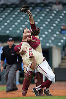 Boston College Eagles catcher Gian Martellini (2) collides with relief pitcher Donovan Casey (30) as he catches a foul pop fly during the game against the North Carolina Tar Heels in Game Five of the 2017 ACC Baseball Championship at Louisville Slugger Field on May 25, 2017 in Louisville, Kentucky.  The Tar Heels defeated the Eagles 10-0 in a game called after 7 innings by the Mercy Rule. (Brian Westerholt/Four Seam Images)