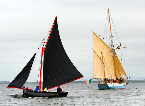 Contrasting styles - a Galway Bay gleiteog welcome the Limerick Trading ketch Ilen to Galway, the first port in her Walled Towns 2021 Project