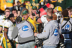 North Dakota State Bison center Joe Lund (73) pours the water bucket on head coach, Craig Bohl, during the FCS Championship game between the North Dakota State Bison and the Sam Houston State Bearkats at the FC Dallas Stadium in Frisco, Texas. North Dakota defeats Sam Houston 39 to 13..