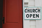 Church is Open sign.  Oysterville Babtist Church, circa 1872 was re-dedicated as an ecumenical church in 1981.  It is now managed by the Oysterville Restoration Foundation as a community resource.  Long Beach Peninsula, Washington State.  USA  Please contact the photographer regarding licensing this image.