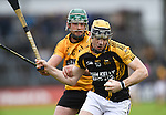Niall Deasy of Ballyea in action against Neil Ryan of Clonlara during the senior hurling county final at Cusack park. Photograph by John Kelly.