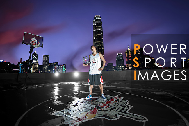 Fong Shing Yee poses on a pontoon basket court in front of the Hong Kong skyline after the Hong Kong's Red Bull King of the Rock on September 1, 2012 in Hong Kong. Photo by Victor Fraile / The Power of Sport Images