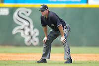 Third base umpire Chris Conroy during an International League game between the Toledo Mudhens and the Charlotte Knights at Knights Stadium August 8, 2010, in Fort Mill, South Carolina.  Photo by Brian Westerholt / Four Seam Images