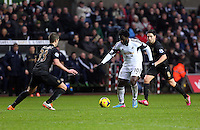 Wednesday, 01 January 2014<br /> Pictured: Wilfried Bony of Swansea (C) against Matija Nastasic (L) and Samir Nasri (R).<br /> Re: Barclay's Premier League, Swansea City FC v Manchester City at the Liberty Stadium, south Wales.