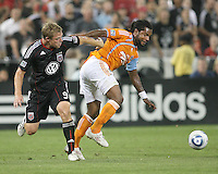 Danny Allsopp #9 of D.C. United loses the ball to Adrian Seioux #51 of the Houston Dynamo during an MLS match at RFK Stadium in Washington D.C. on September  25 2010. Houston won 3-1.