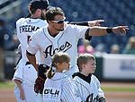 Reno Aces prepare for the start of a game against the Fresno Grizzlies at Greater Nevada Field in Reno, Nev., on Tuesday, April 26, 2016. <br />