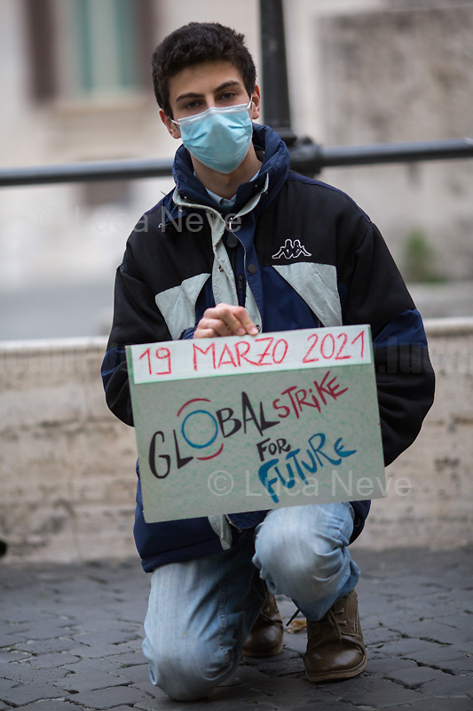"Rome, Italy. 19th Feb, 2021. Today, Fridays For Future Roma (1.) held a sit-in outside the Italian Parliament in Piazza Montecitorio called ""The Transition We Want"". The aim of the rally was to call the new Italian Government, led by Professor Mario Draghi, to act for an immediate plan, investments and policies against the so called ""climate changes"" and the consequent climate crisis. The ""Fridays for Future"" actions are a series of global demonstrations directly related to Greta Thunberg (2.), the 16 year old ""Swedish political activist seeking to stop global warming and climate change, [who] in August 2018 became a prominent figure for starting the first school strike for climate, outside the Swedish parliament building"" (source Wikipedia.org, 3.). <br /> <br /> Footnotes & Links:<br /> 1. https://facebook.com/FFFroma  <br /> 2. @GretaThunberg (Personal Twitter page - No Personal Website available) <br /> 3. https://en.wikipedia.org/wiki/Greta_Thunberg"