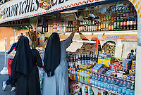 Two nuns buy food at a concession stand, Rome, Italy