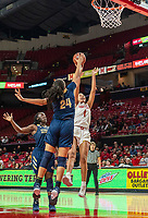 COLLEGE PARK, MD - NOVEMBER 20: Kayla Mokwuah #24 of George Washington defends against a shot by Shakira Austin #1 of Maryland during a game between George Washington University and University of Maryland at Xfinity Center on November 20, 2019 in College Park, Maryland.