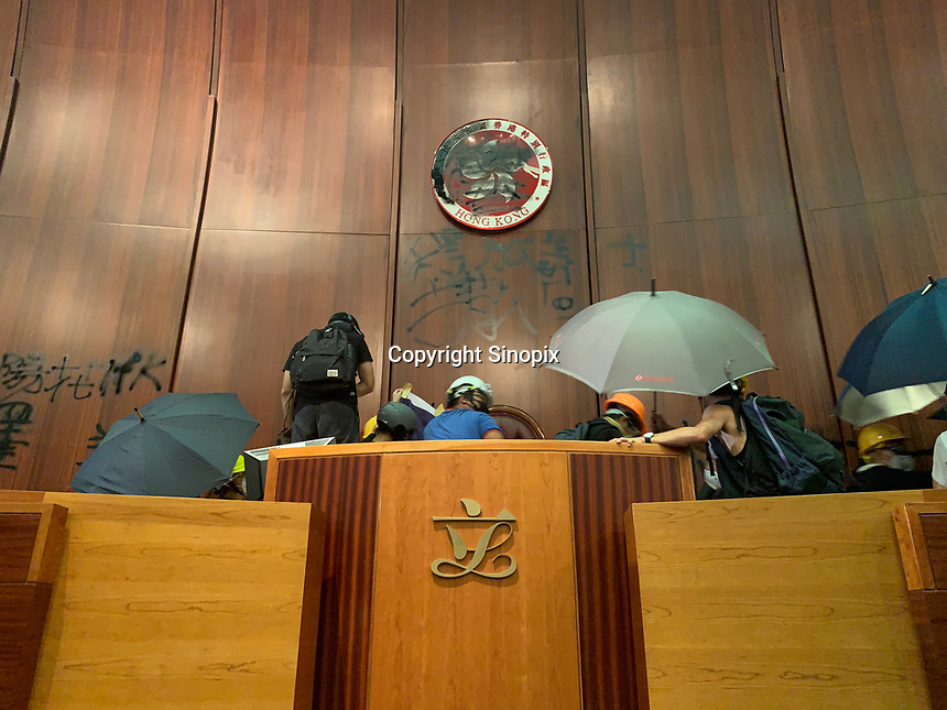 Mostly student and youth demonstrators break into the Hong Kong's Legislative Council Chamber 1st July 2019. The umbrella is seen as the symbol of the movement. The protestors caused widespread damage and are demonstrating against the extradition bill, since suspended, that was being pushed through the Hong Kong Council.