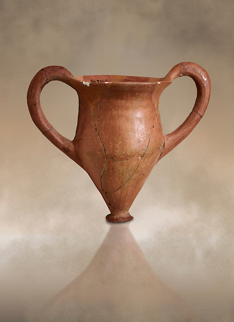 Hittite terra cotta two handled drinking vessel. Hittite Period, 1600 - 1200 BC.  Hattusa Boğazkale. Çorum Archaeological Museum, Corum, Turkey. Against a warm art bacground.