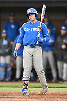 Designated hitter TJ Collett (5) of the Kentucky Wildcats bats in a game in the rain against the University of South Carolina Upstate Spartans on Saturday, February 17, 2018, at Cleveland S. Harley Park in Spartanburg, South Carolina. Kentucky won, 6-5, in 10 innings. (Tom Priddy/Four Seam Images)