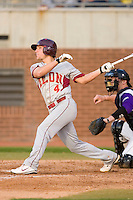 Bennett Davis #4 of the Elon Phoenix follows through on his swing versus the East Carolina Pirates at Clark-LeClair Stadium March 29, 2009 in Greenville, North Carolina. (Photo by Brian Westerholt / Four Seam Images)