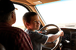 During a visit to his grandpa's northern California farm, my older son, age five, is delighted to try out the steering wheel.
