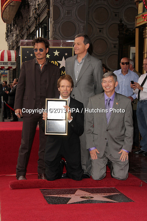 LOS ANGELES - JUN 24:  Johnny Depp, Bob Iger, Jerry Bruckheimer, Leron Gubler at  the Jerry Bruckheimer Star on the Hollywood Walk of Fame  at the El Capitan Theater on June 24, 2013 in Los Angeles, CA