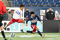 FOXBOROUGH, MA - OCTOBER 16: Dominick Hernandez #15 of North Texas SC clashes with Ryan Spaulding #34 of New England Revolution II during a game between North Texas SC and New England Revolution II at Gillette Stadium on October 16, 2020 in Foxborough, Massachusetts.