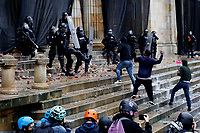 BOGOTA, COLOMBIA - MAY 05: Protester clash with police during national strike on May 5, 2021 in Bogota, Colombia. Despite that the ruling party announced withdrawal of the unpopular bill for a tax reform and the resignation of the Minister of Finances, social unrest continues after a week. The United Nations human rights office (OHCHR) showed its concern and condemned the riot police repression. Ongoing protests take place in major cities since April 28. (Photo by Leonardo Munoz/VIEW press/Corbis via Getty Images)