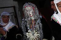 BULGARIA, Ribnovo, January 24, 2010. Bulgarian muslim bride and groom attend their wedding ceremony in the remote village of Ribnovo, in the Rhodope moutain region, south of Bulgaria. Bulgarian Muslims, which today are nearly 8% of the country's population and the largest muslim minority community in the European Union, revived their cultural and religious traditions after the fall of communist regime in Bulgaria in 1989. .BULGARIE, Ribnovo, 24 Janvier 2010. Un jeune couple de mariés Bulgares de confession musulmane participent a leur cérémonie de mariage dans le petit village de Ribnovo dans les montagnes des Rhodopes en Bulgarie. La minorité musulmane qui représente aujourd'hui près de 8% de la population totale du pays et qui est la plus large majorité musulmane dans les pays de l'Union Européenne a ravive ses traditions culturelles et religieuse après la chute du régime communiste Bulgare en 1989.