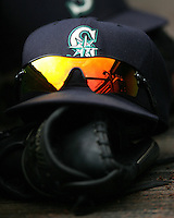 Seattle Mariners baseball cap and glove. Photo by Andrew Woolley / Four Seam Images.
