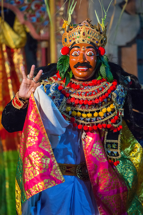 Bali, Indonesia.  Dancer Re-enacting Scenes from Balinese Hindu Mythology, part of a ceremony in hope of a bountiful rice harvest.  Pura Dalem Temple, Dlod Blungbang Village.